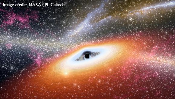 Artist's impression of a gas disk feeding a massive black hole, while emitting radiation